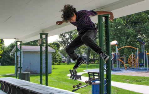 David Fritz (9) kickflips on a park table. He landed the trick successfully.